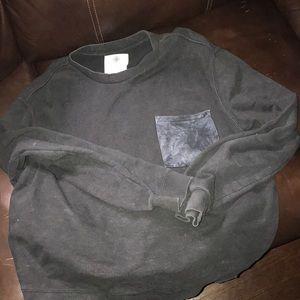 Black On the Byas sweatshirt.